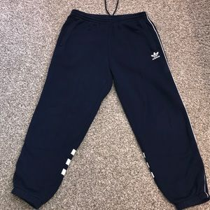 Adidas blue sweat pants with white stripes